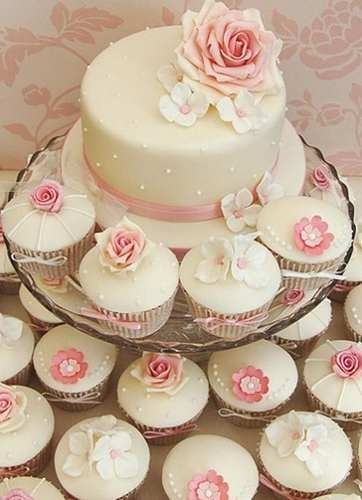 If you aren't confident in the rose cupcakes, I think this is a nice alternative... super simple and clean looking with touches of color in the decorations.... I think you would need to make the top cake relatively simple like this too... and maybe use some fresh flowers...