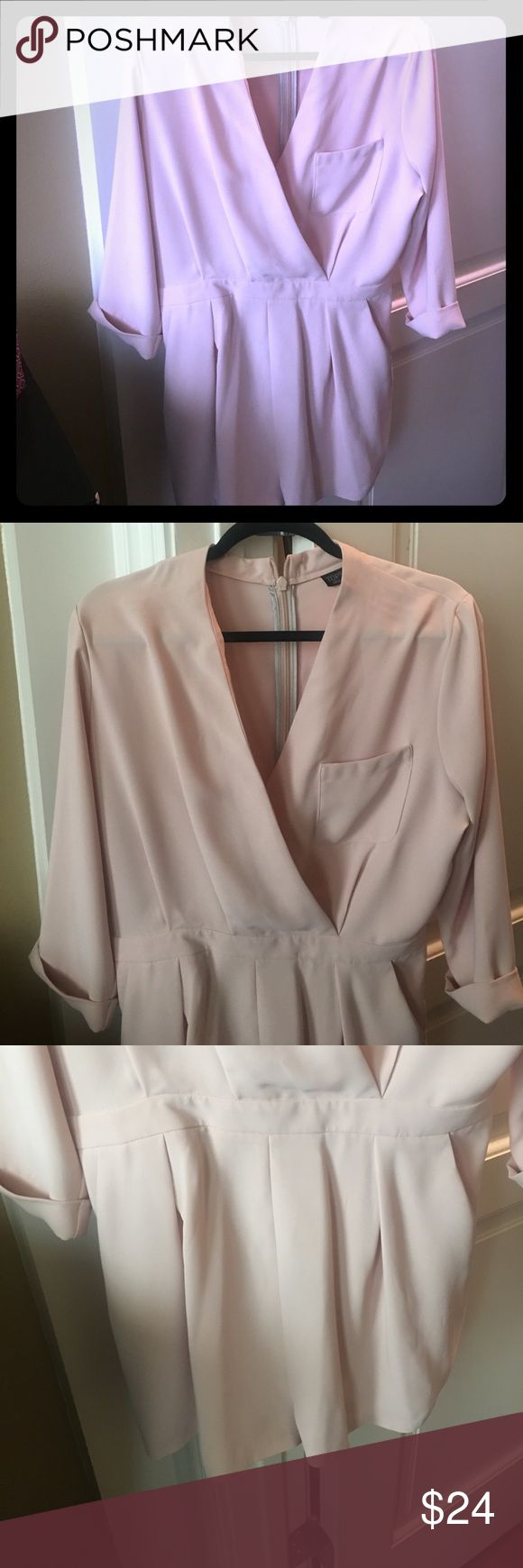 Top shop blush pink ladies romper TopShop ladies blush pink romper. Very feminine design. Bought at the Topshop store in Singapore. Only worn once. Item is in like new condition, no damage Topshop Pants Jumpsuits & Rompers