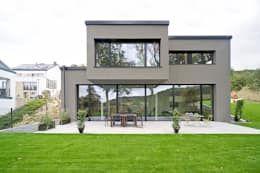Projekty, nowoczesne Domy zaprojektowane przez massive passive