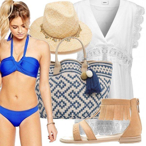 Uno dei colori dell'estate è lo snorkel blu, il bellissimo colore del costume che ho scelto per voi. Sopra ci mettiamo un vestitino bianco candido con inserti in pizzo. Gli accessori sono davvero glamour: cappello di paglia con dettagli gioiello, infradito con frange e la borsa davvero bellissima e particolare!