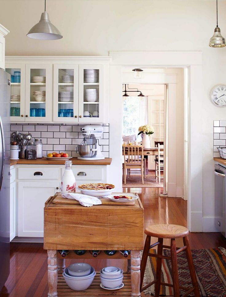 "White kitchen with subway tile in old Craftsman cottage via What It Was Like to Film the Pilot for ""Home Town"" on HGTV - Hooked on Houses"