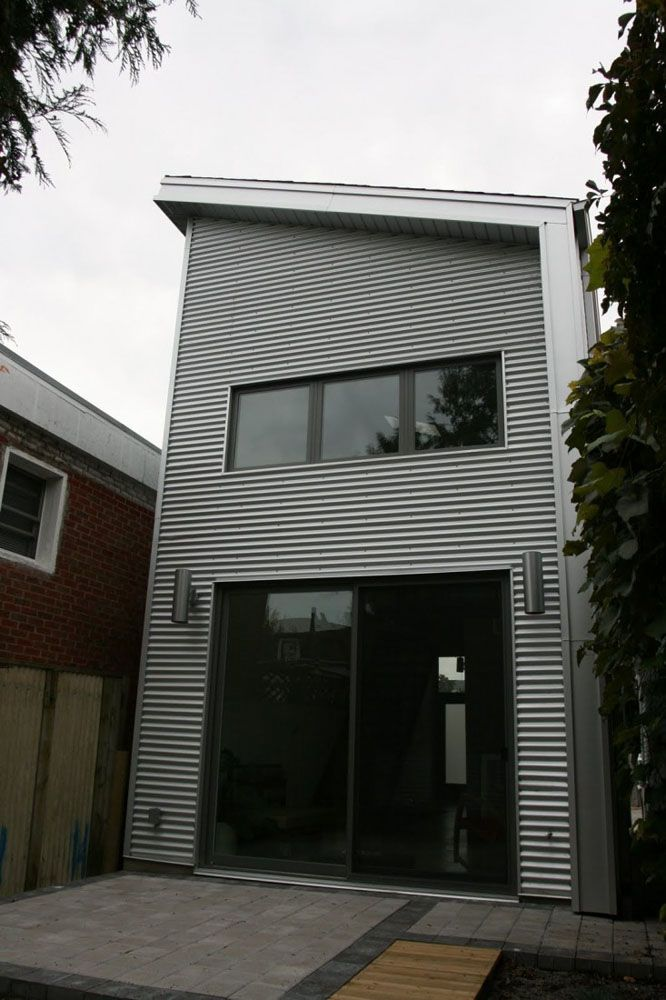 Wavy galvanized steel siding -Small House on a Budget