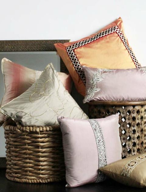 Repurpose Saris into cushion covers. Beautiful!
