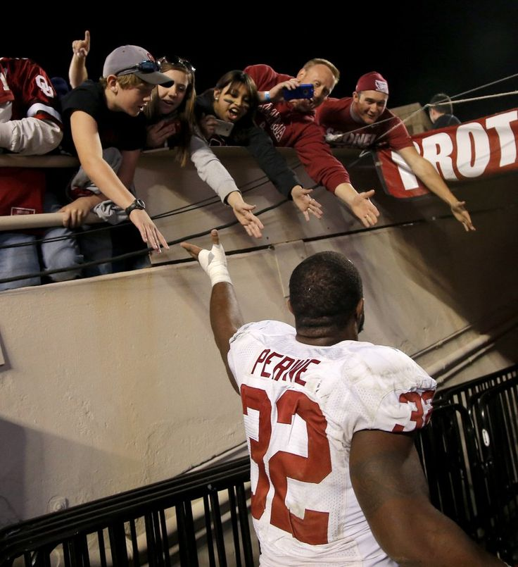 Oklahoma's Samaje Perine (32) slaps hands with fans after a college football game between the University of Oklahoma Sooners (OU) and the Texas Tech Red Raiders at Jones AT&T Stadium in Lubbock, Texas, Saturday, November 15, 2014.  Photo by Bryan Terry, The Oklahoman