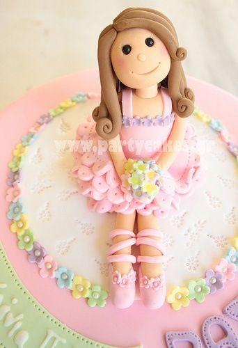 Ballerina cake topper.. love the hair!