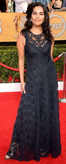 Sarita Choudhury: 2014 SAG Awards  The actress attended the 2014 SAG Awards wearing a sleeveless black gown with a patterned overlay draped over simple black material.  Read more: http://www.usmagazine.com/red-carpet/sarita-choudhury-2014-sag-awards-2014181#ixzz2qrOLX77N