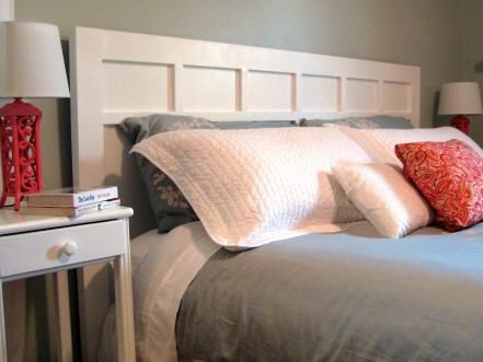 We modeled this headboard from one we saw in a popular home-decor catalog. It is very simple to build — standard-size lumber is fastened to a large piece of plywood, then the whole piece is painted white.