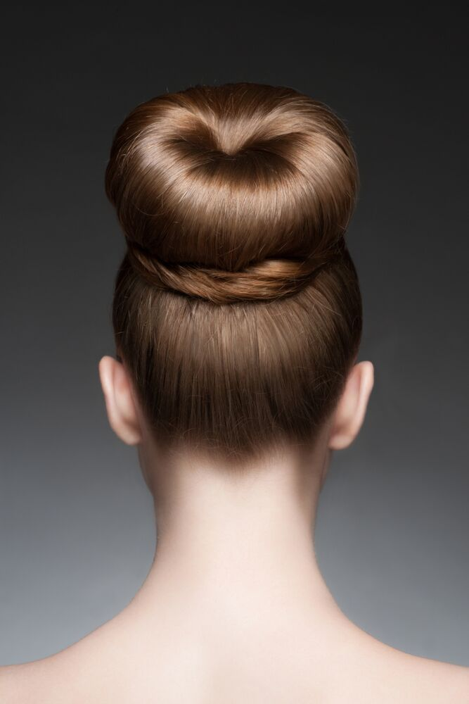 3 steps to making a hair bun donut: 1. Make a ponytail on top of your head. 2. Using a spongy donut, roll the tip of your hair around it towards the base of the ponytail. 3. Secure the tips with a clip or hairpin to hold the bun. Stunning!