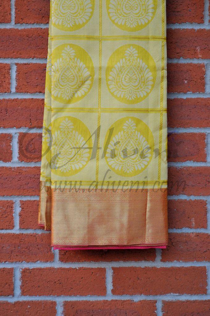 Lemon Yellow Kuppadam Saree with zari checks and white motifs weaved all over