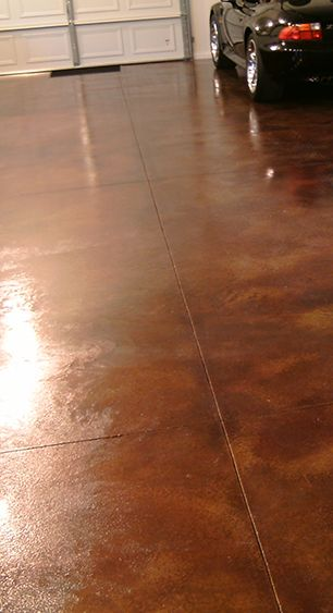 This lovely 800 square foot garage floor project was acid stained using Cola and diluted Coffee Brown Concrete Acid Stains.