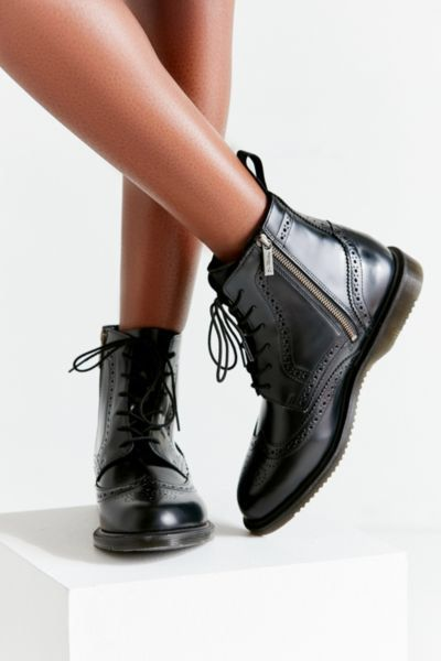 b9a1b25ac4b Check out Dr. Martens Delphine 8-Eye Brogue Boot from Urban Outfitters