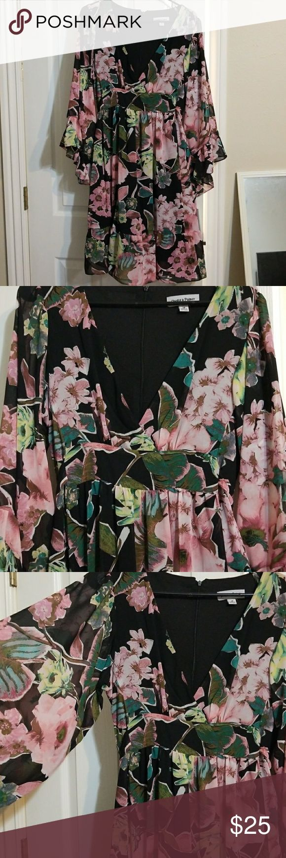 Black and Sage Surplis Dress This dress features a floral pattern with a V-neck front, flowy sleeves, and a tie in the back so it can be adjusted to fit your waist. It has never been worn. Shelby & Palmer Dresses