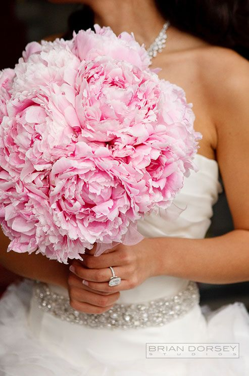 Full, pink peonies make for ultra femme florals for this glamorous bridal look.