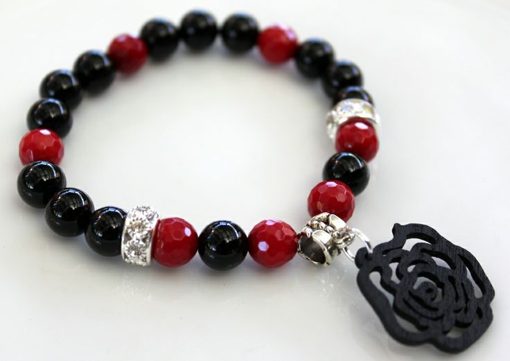 Contemporary Bracelet B090  $25 This bracelet is made up of Faceted Red Coral Beads,  Black Agate Beads and Silver Plated Dimanté Beads. I added a Wood Carved Rose Charm in the centre.  Easy to get on and off, this is a great piece to wear alone or stacked with other bracelets in your wardrobe. Made with two layers of sturdy elastic cord, the bracelet will comfortably fit an average size wrist.  Length – 19cm.