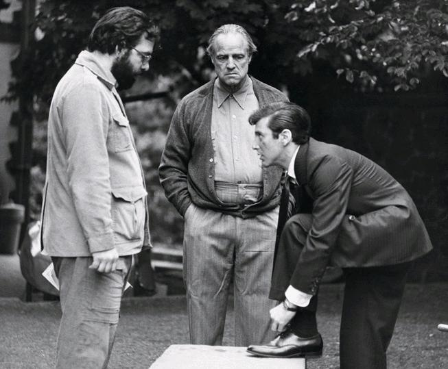 "Francis Ford Coppola, Marlon Brando and Al Pacino on the set of ""The Godfather"""