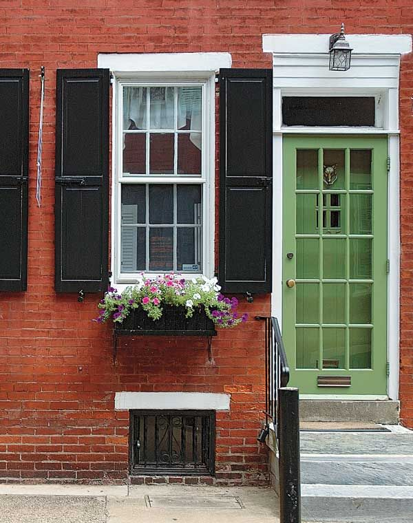 Love this brick black shutters with white accents green Dark green front door paint