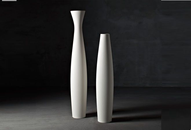 "Scarlett Planters Pot by Serralunga. Curvy presence outdoor and indoor where the pleated effect of the surface makes the item softer and more ""dressed-up""."