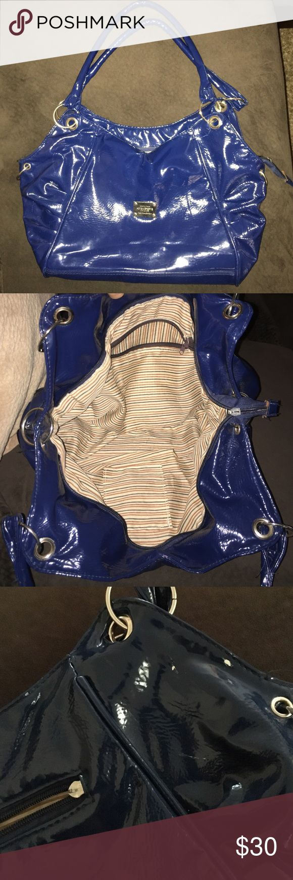 Purse I bought this in Vegas a few years ago. Used. There are missing/ broken pieces on the zipper parts as pictured, but zippers are still functional. And 3 tiny scuff marks also pictured. Still in good condition! Bags Shoulder Bags