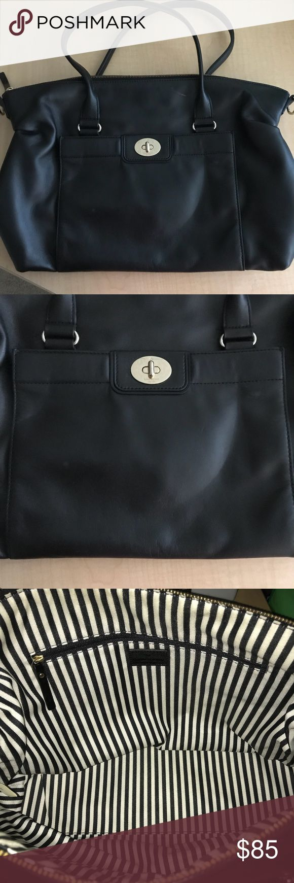 Kate Spade Tote Bag A black leather tote bag from Kate spade. It has two small handles for you to carry and put on your forearm. The front has a small pocket with twist closure. The inside is black and white striped with pockets on the side. It's a medium to large size bag and has a zipper. It has one scratch on the front. It does not come with a large strap. kate spade Bags Totes