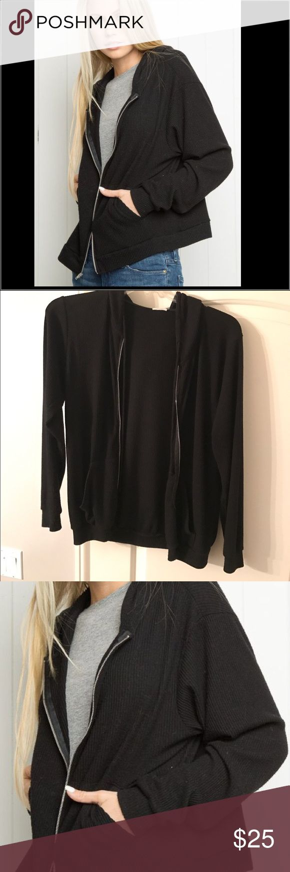 Brandy Melville Black Zip Hoodie Really comfy and in great condition. Has two pockets and a hoodie. Ribbed design. Great for sweater weather Brandy Melville Tops Sweatshirts & Hoodies