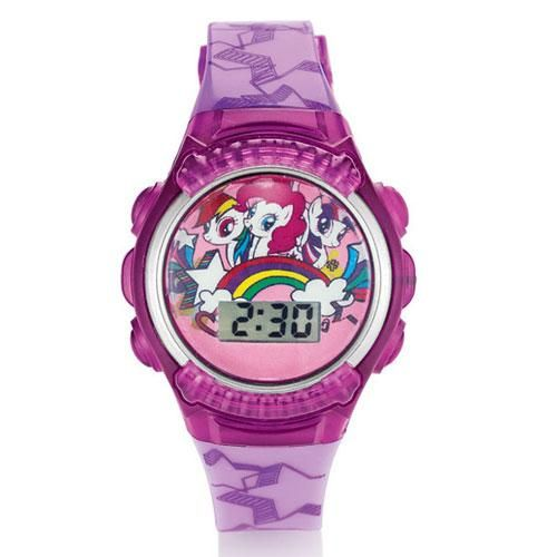 """Flashes & lights up! Your wrist twinkles and sparkles every hour with this adorable digital watch. Flashes and lights up. Watch face and strap are various shades of pinks and purples.• Face: 1 3/8"""" W; Strap: 8"""" L with buckle closure• Wipe clean with damp cloth• Ages 6 and up• Imported© 2014 Hasbro. All Rights Reserved."""