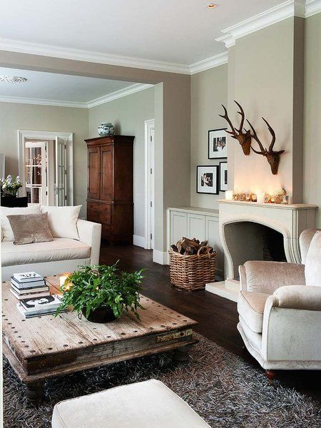 square rustic coffee table, DR cabinet, antlers, greige walls