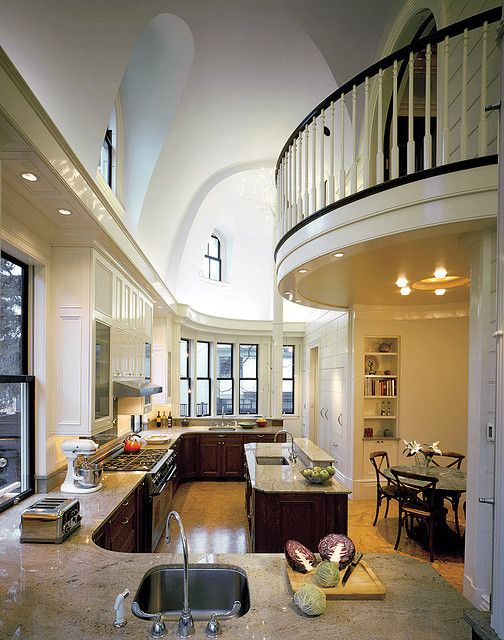 Double height ceiling balcony over kitchen.