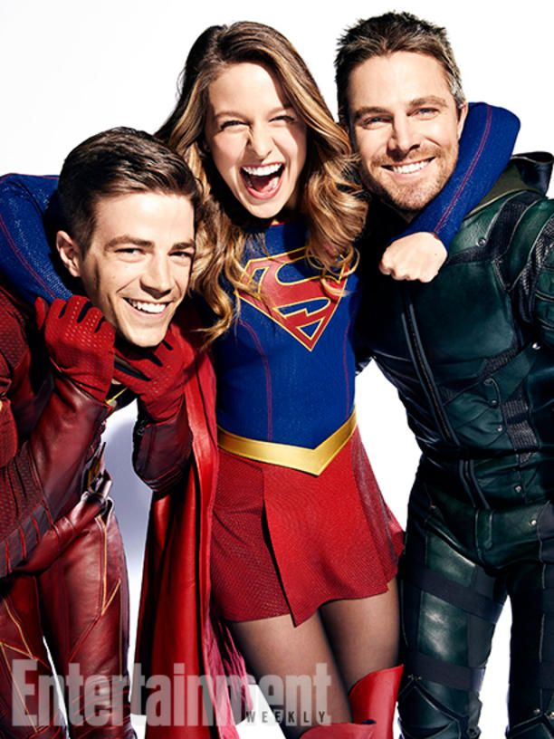 All In The Family: Inside DC's Ultimate Superhero Crossover - Photo: Grant Gustin (The Flash), Melissa Benoist (Supergirl), and Stephen Amell (Green Arrow)