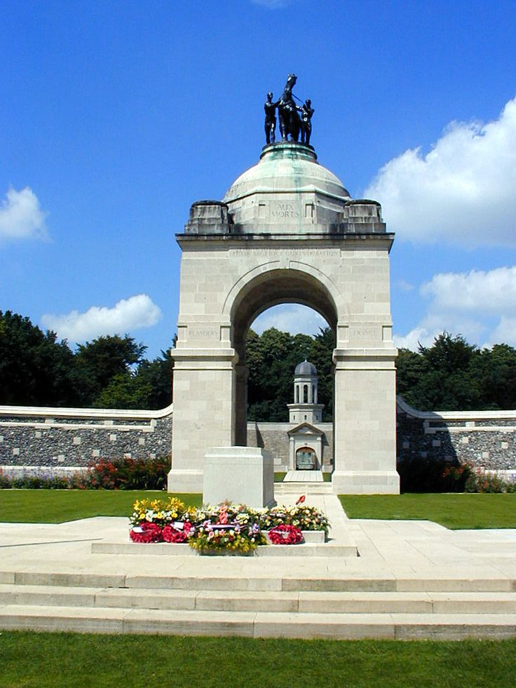 Delville Wood A bronze sculpture by Alfred Turner of a horse and two male figurs is located on top of the arch.