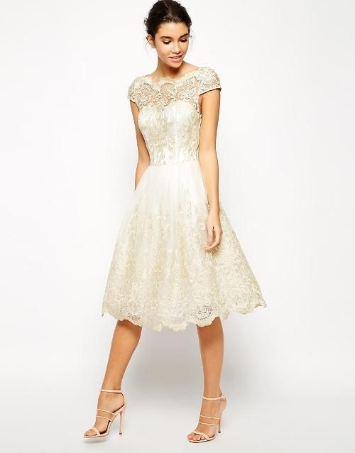 A metallic lace midi dress | Brides.com