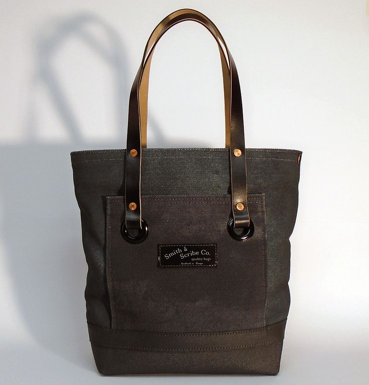 """Hand dyed cotton canvas tote bag - seaweed green with black pocket and black leather strap ●  Size: 5,5"""" x 11"""" x 14,2"""" - American ● 14 cm x 28 cm x 36 cm - European ● In case of order, please contact us with the following e-mail address: info@smithandscribeco.com #cottoncanvas #canvasbag #handmade #handdyedcanvas #handmadeineurope #1920's #1930's #1940's #totebag #copperrivet #italianleather #premiumingredients"""