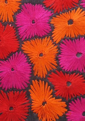 """Gorgeous embroidery from the Indian design company Botto. I love the use of orange and fuchsia together and the way the darker colored background emphasizes the forms. This appears to be just straight stitches, but with such rhythm!"" #KnittingGuru"