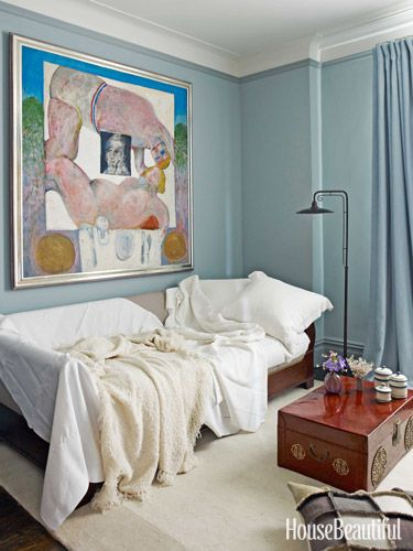 Little sunlight reaches the guest room, so the homeowners asked for plenty of warm, saturated color. Doherty chose Dix Blue for the walls and Oval Room Blue for the trim, both by Farrow & Ball. The painting is by Whitney Lee Savage, done in 1964.