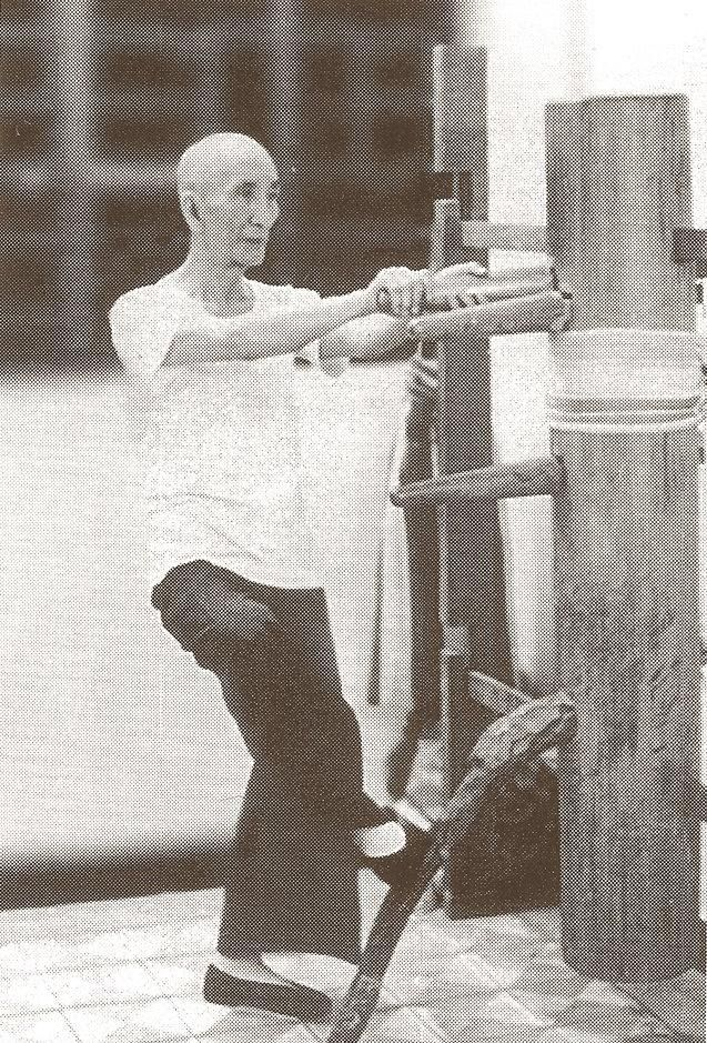 Ip Man, in his twilight years, training on a wooden dummy. No excuse not to continue training.