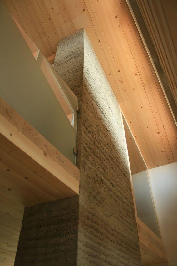 rammed earth column - beautiful texture, mass lends to heavy look