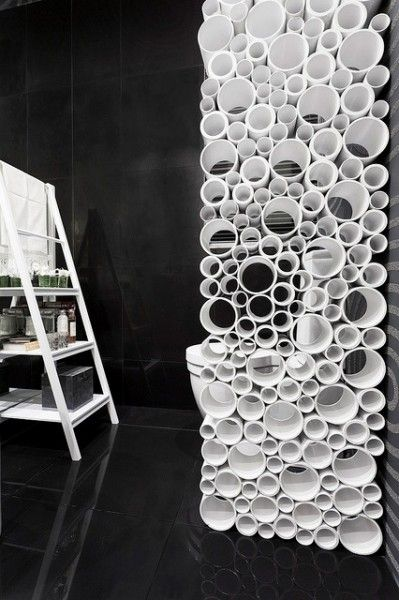A unique (but likely time consuming) custom room divider made from cut sections of PVC piping.