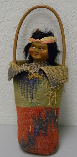 Very interesting doll in the carrier. Ebay