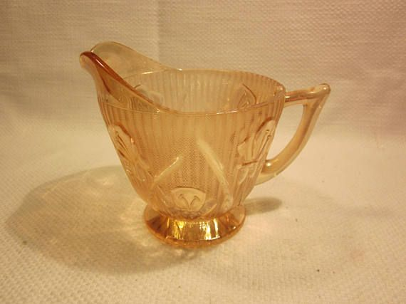 Lovely Iris and Herringbone depression glass creamer, in iridescent color. In excellent condition with no cracks or chips. Measures 4 inches high. Thank you for visiting outoftheatticshop