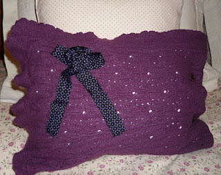 pillows made from a cardigan and blouse.