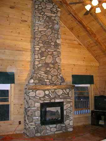 rustic fireplaces   Rustic River Rock Fireplace