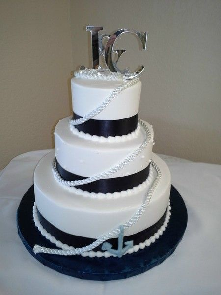 nautical wedding cake - i like the rope cutting across the different layers