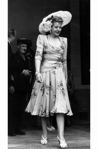 """How to dress for political success"" article by Harper's Bazaar. Eva Peron - The Full Package. Article tracks successful women in ""recent"" political history including Jackie O, Eva Peron, & others"