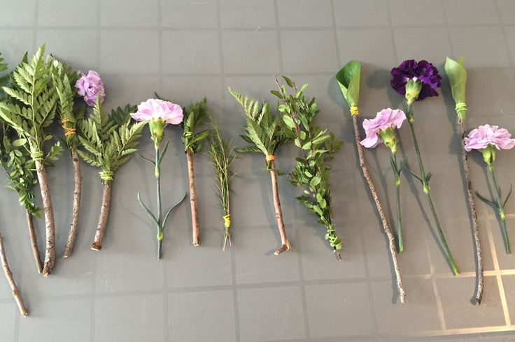 We created paint brushes for the children using found twigs and leftover flowers and greenery from a bouquet. We tied them to the branches using small elastic bands.