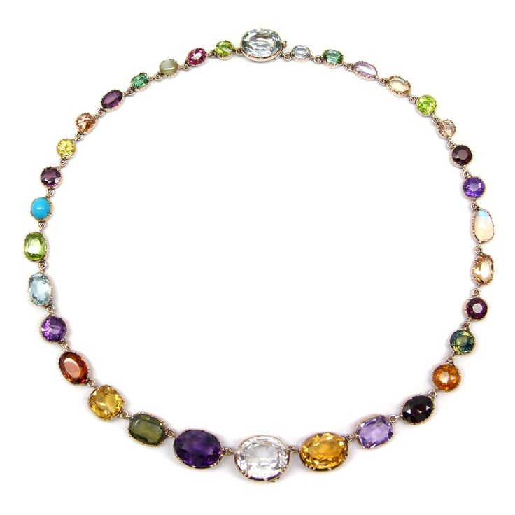 19th century vari-coloured gem and gold necklace, c.1885, the cushion, round and oval cut stones open cut-down collet set, including moonstone, topaz, amethyst, peridot and garnets.