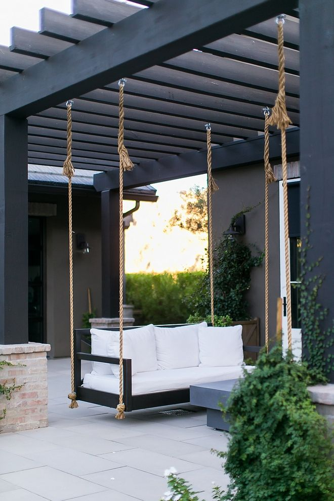 Black Pergola Backyard With A Black And White Color Scheme