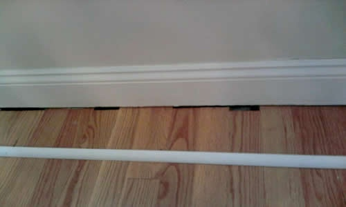 add quarter round molding to the bottom of baseboards after installing the laminate to cover gaps
