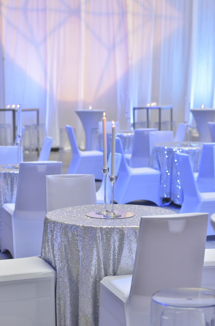Supper club seating with silver sequinned tablecloths
