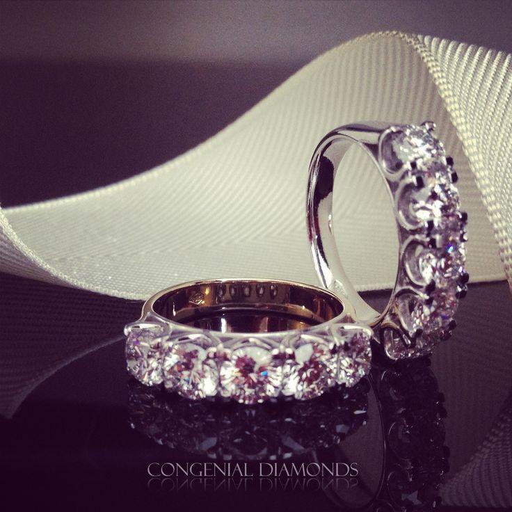 Classic five stone eternity ring set with round diamonds