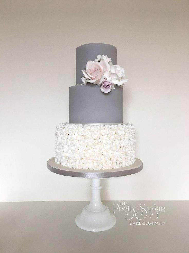 Grey and white ruffles wedding cake with sugar roses and hydrangeas