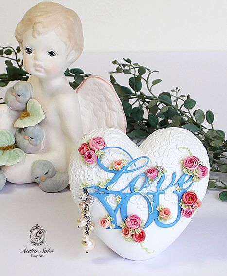 フランフランのオブジェに樹脂粘土モデナでバラや小花を作り貼り付けました。